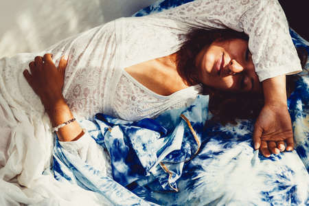 Beautiful sleeping woman in white ornamental clothes. Imagens