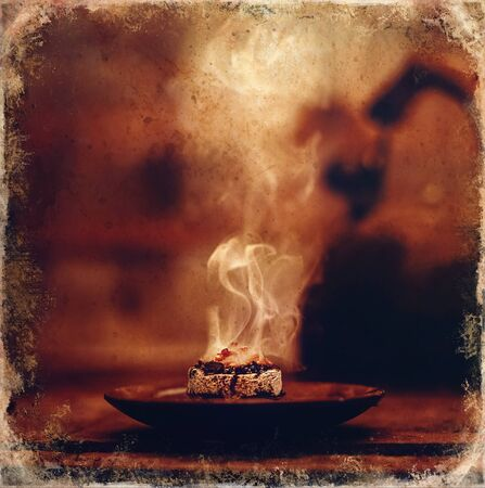 Frankincense burning on a hot coal.