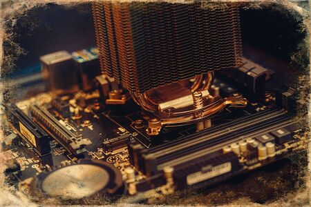 Repair of a computer, detail of disassembled computer, old photo effect.