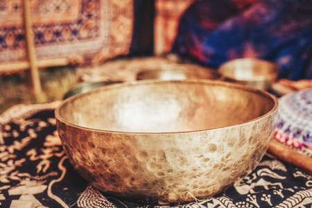 Beautiful tibetian bowl with golden light reflections.