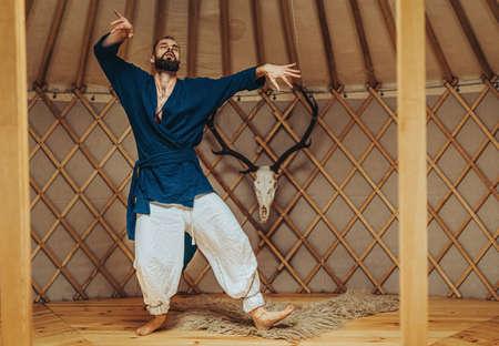 dancing warrior, ceremonial dance in a yurt.