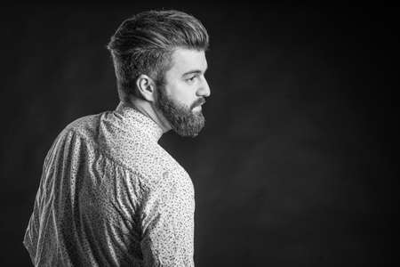 homogeneous: Black and white photos in the studio, bearded man Stock Photo