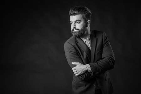 businessman suit: Black and white photos in the studio, bearded man Stock Photo