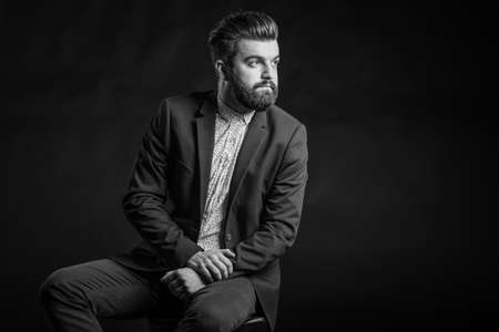 male fashion model: Black and white photos in the studio, bearded man Stock Photo