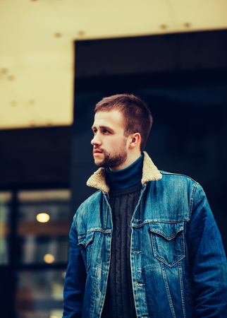 metrosexual: young man in a denim jacket posing in the city Stock Photo