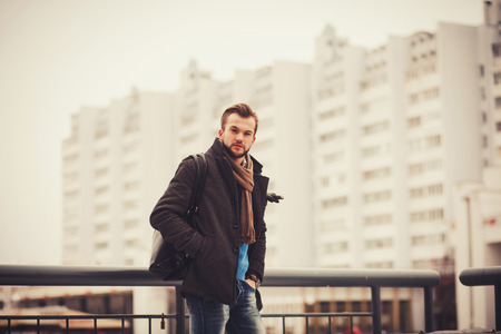portrait of a young fashion man on city background Stock Photo