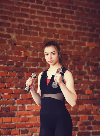 young beautiful woman training in gym Stock Photo