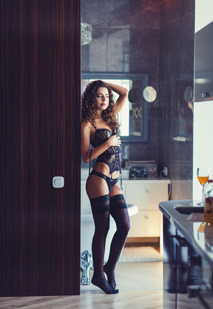Attractive young woman posing in erotic lingerie. Sexy fashion model in underwear. Stock Photo