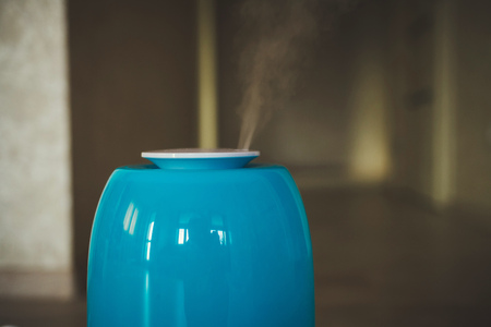 the steam from the humidifier. health. copy space Фото со стока
