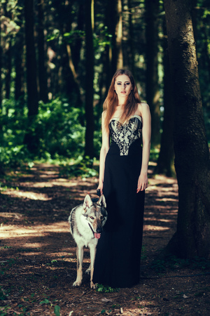 Cute fashionable woman and dog outside Stok Fotoğraf