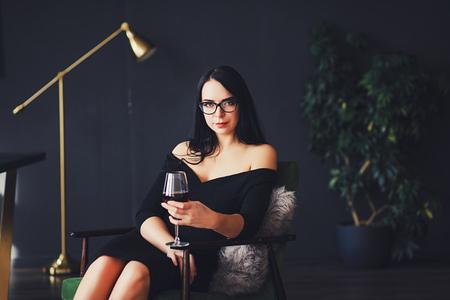 Beautiful woman with wine glass and black dress 版權商用圖片