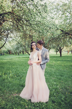 full-length portrait of the newlyweds in the spring park Imagens