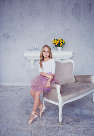Little ballerina in tutu skirt, studio atmosphere