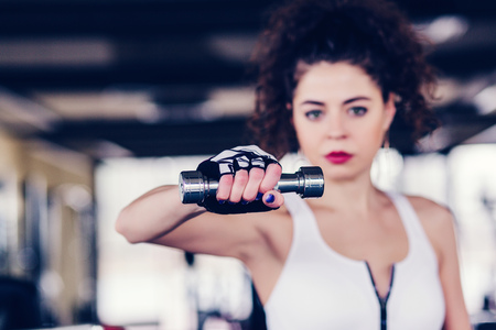 Strong sporty woman weightlifting at the gym