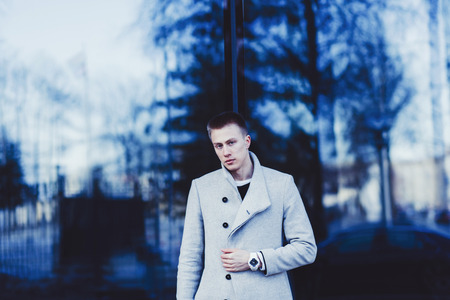 portrait of a fashion model with copy space, man wearing coat and watch