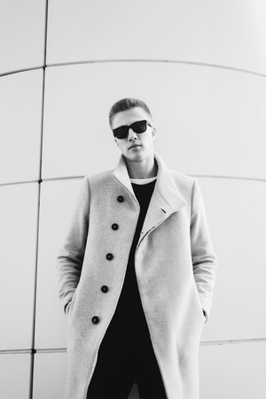 Black and white portrait handsome man in a coat