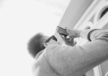 Man photographing with mobile smartphone city Stock Photo
