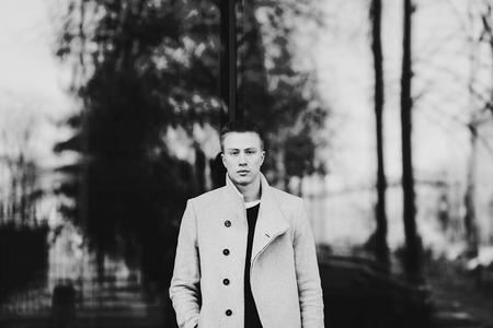 fashion man posing in stylish coat