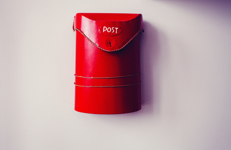 red mailbox on wall Stock Photo