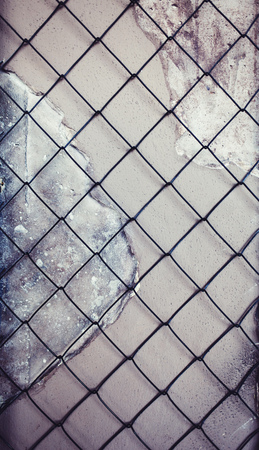 black metal grid on concrete wall background