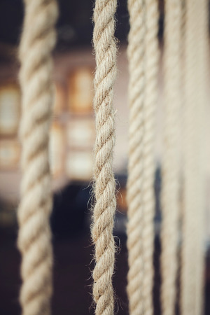 The rope is hanging in the room. decorative element