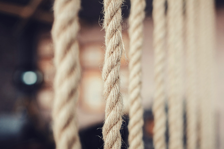a row of rough ropes in the interior. copy space