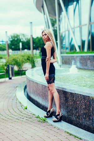 Beautiful sexy woman posing in summer dress.