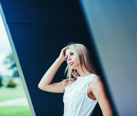 Beauty blonde young woman in white dress Stock Photo