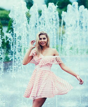 Young beautiful girl posing in a summer dress