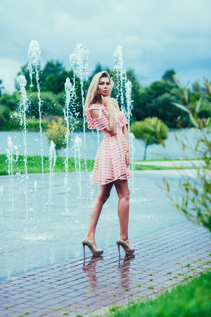beautiful young blonde woman in nice spring dress. Fashion spring summer photo