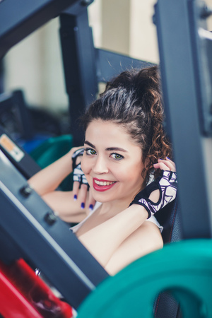 Happy woman doing indoor in a fitness club Stock Photo