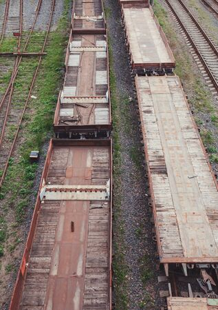 Freight trains on the railway station. Wagons with goods on railroad. Heavy industry. Industrial conceptual scene with trains. 版權商用圖片