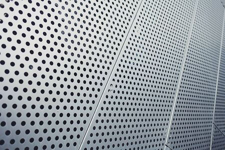 shiny metal panel or texture with circles