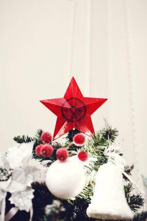 Red star christmas decoration on christmas tree