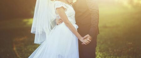 Young wedding couple enjoying romantic moments on meadow