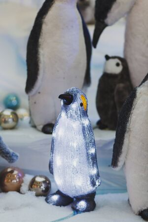Christmas toys-shining penguin in the Mall Stock Photo