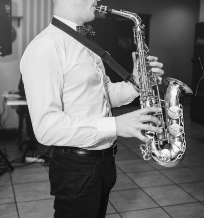 Saxophone player hands saxophonist playing jazz music.