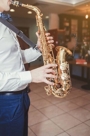 Saxophone, music instrument played by saxophonist player musician Banque d'images