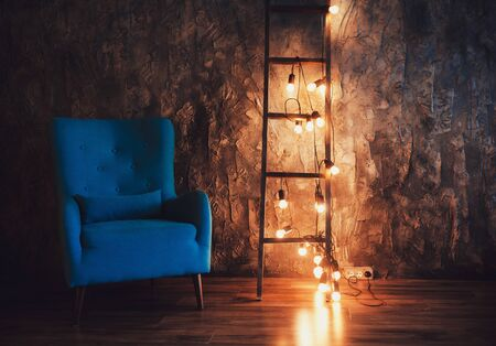 stylish loft interior. rough walls and ladder with lamps