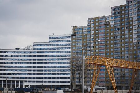 Construction site background. Crane and new multi-storey buildings. Imagens