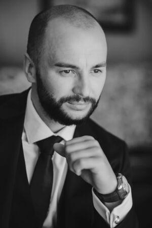 Close up portrait of young successful stock-market broker guy wearing suit with tie Foto de archivo