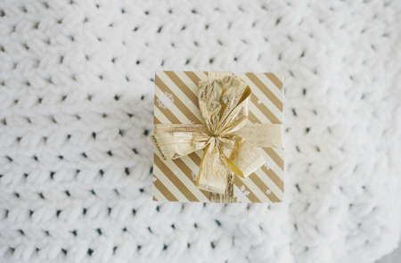gift box with ribbon in room. christmas season 免版税图像