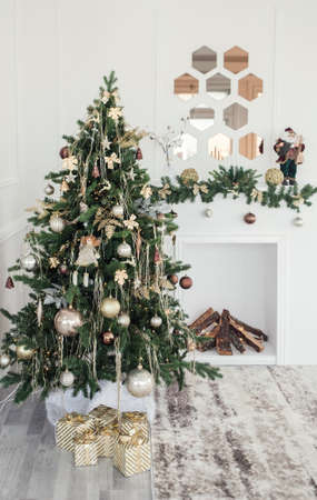 Cozy beautiful modern design of the room in light colors decorated with Christmas tree and decorative elements fireplace
