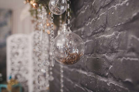 composition of light bulbs and balls on a Christmas decoration hanging on the wall