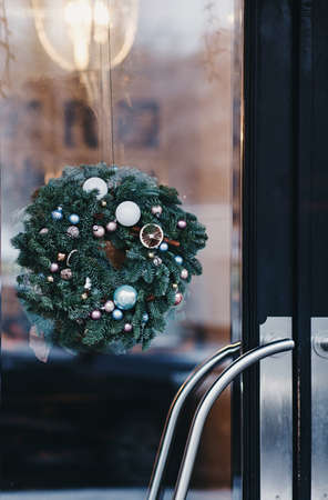 Christmas decoration of the door of a European cafe. new year in the city