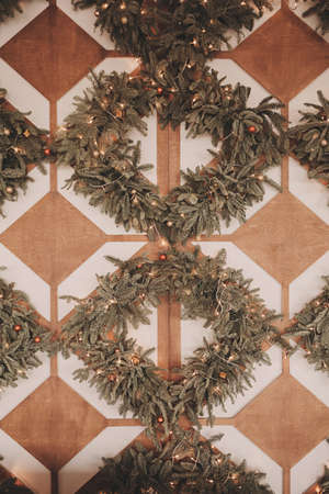Christmas concept - Christmas wreaths with lights on the wall 免版税图像