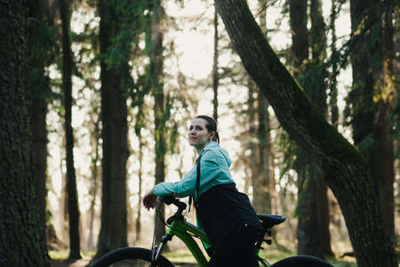 Young woman traveling with bicycle in park. healthy active lifestyle traveler