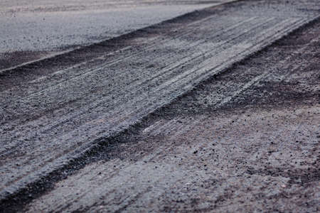 asphalt road with removed surface. road resurfacing.