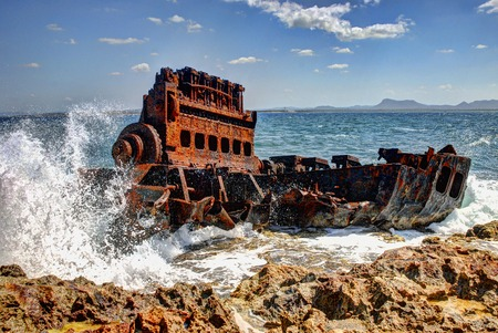 holguin: Remains of wrecked boat engine in the coastal city of Gibara, north of the province of Holguin, Cuba.