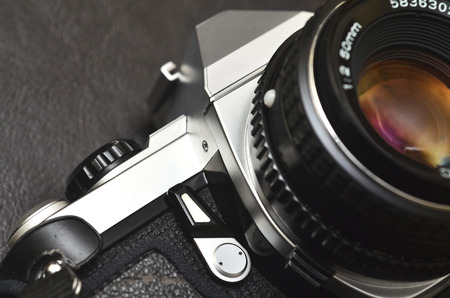 50mm: Macro close up shot of a silver classic film camera SLR with lens Stock Photo